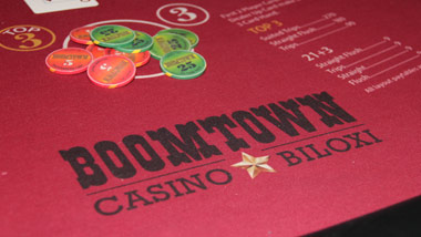 red velvet table with Boomtown casino Biloxi logo and gaming chips